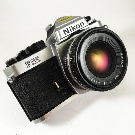 film camera reflex 1983 nikon fe2 chrome nikkor 50mm 1.8 35mm vintage
