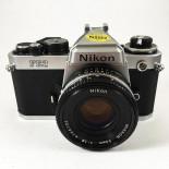 appareil reflex argentique nikon fe2 chrome 50mm 1.8 nikkor 35mm film