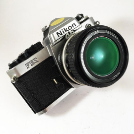 film camera reflex 1983 nikon fe2 chrome nikkor 28mm 3.5 35mm vintage