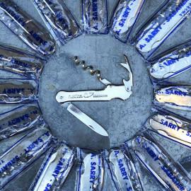 petit couteau suisse decapsuleur tire bouchon semences rustica publicitaire pub 1970 1980 métallique
