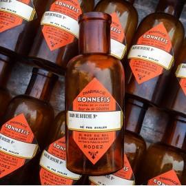petite bouteille orange jaune verre bain de bouche bonnefis pharmacie ancienne vintage 1930 1940 flacon