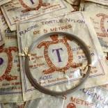 racine nylon fishing line tortue turtle paper bag vintage 1930